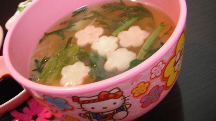 miso soup with edible chrysanthemum garland,onions,carrots,cherry blossom-shaped Japanese bread-ike gluten and Napa cabbage greens seasoned with dried bonito stocks,dried young sardine stock and organic miso 春菊とタマネギ、人参、白菜菜、桜麩の御味噌汁。カツオ、いりこだし有機味噌使用。