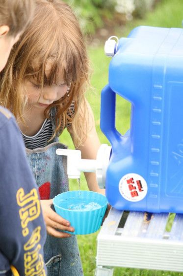 mud kitchen activity - happy hoolians - mud pies, mud soup, messy play