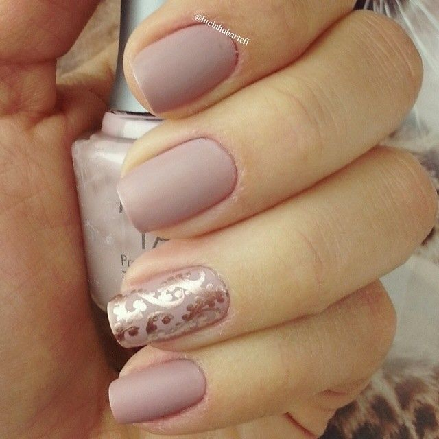 Nude nails with accent nail.