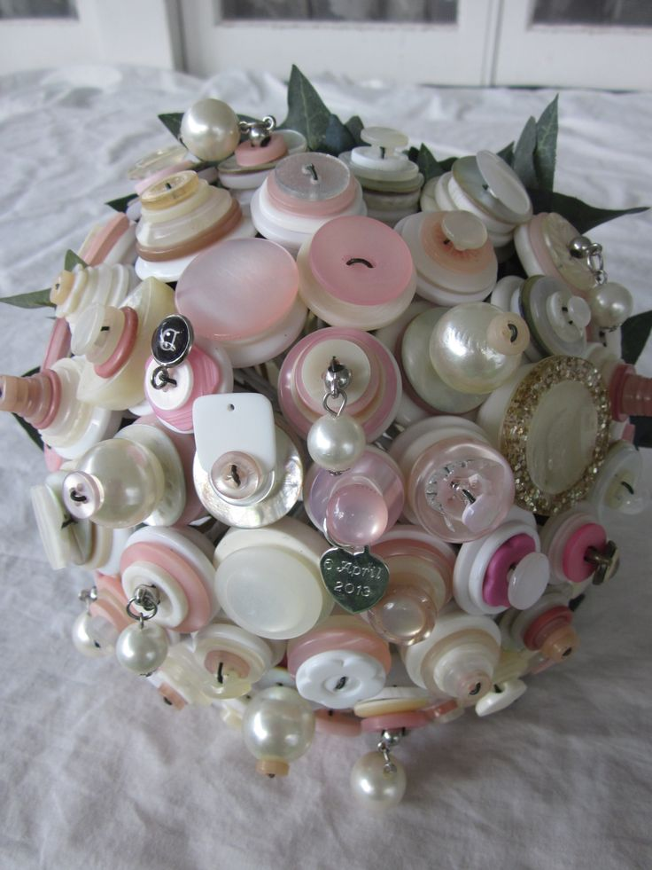 white cream and ivory with soft pinks, pearls and bling