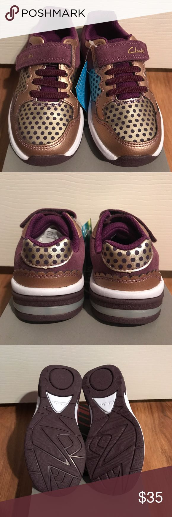 Clarks Light Up Shoes- toddler sz 9 New in box. Light up shoes. Elastic laces with Velcro at top to easily slip on and off. Gold leather, purple suede Clarks Shoes Sneakers