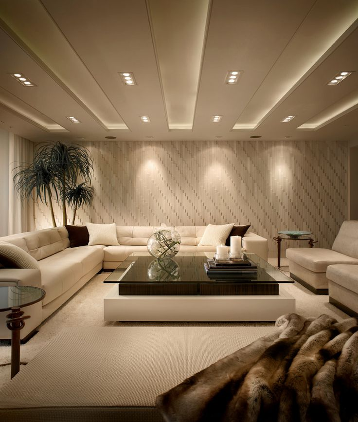 Strategic lighting highlights textured living room walls   Decoist. 25  best ideas about Living Room Lighting on Pinterest   Led room