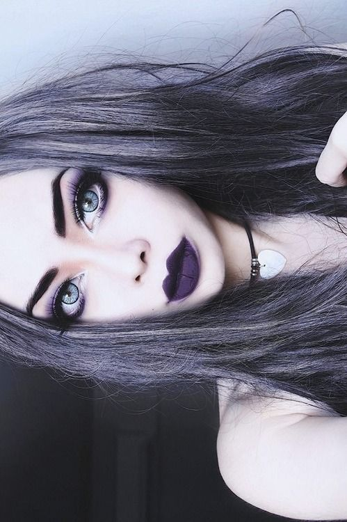 gorgeous pale skin, steel grey hair and purple lips