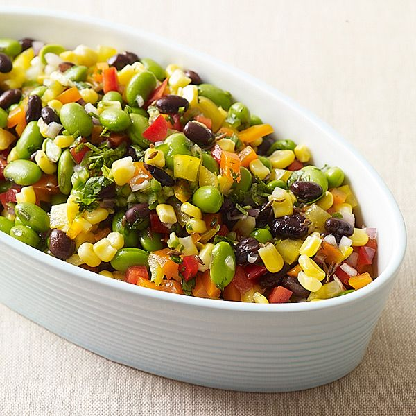Cumin-Lime Confetti Salad Recipe Salads with canned black beans, edamame, frozen corn kernels, serrano chile, red bell pepper, orange bell pepper, yellow peppers, purple onion, cilantro, fresh lime juice, olive oil, lime zest, kosher salt, sugar, cumin seed