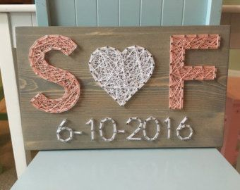 Family string art with photo clips (fits two photos, size 4 by 6) - great addition to a gallery wall or to display your family photos! Size is 11 by 15. You may choose the wood stain (dark brown, light brown, gray, white, or aqua) and string colors for the letters/heart. A sawtooth hanger is added to every board. Shipping fees vary, so I will refund the difference if its less than the listed amount! Check out our larger photo board- https://www.etsy.com/listing/2928...