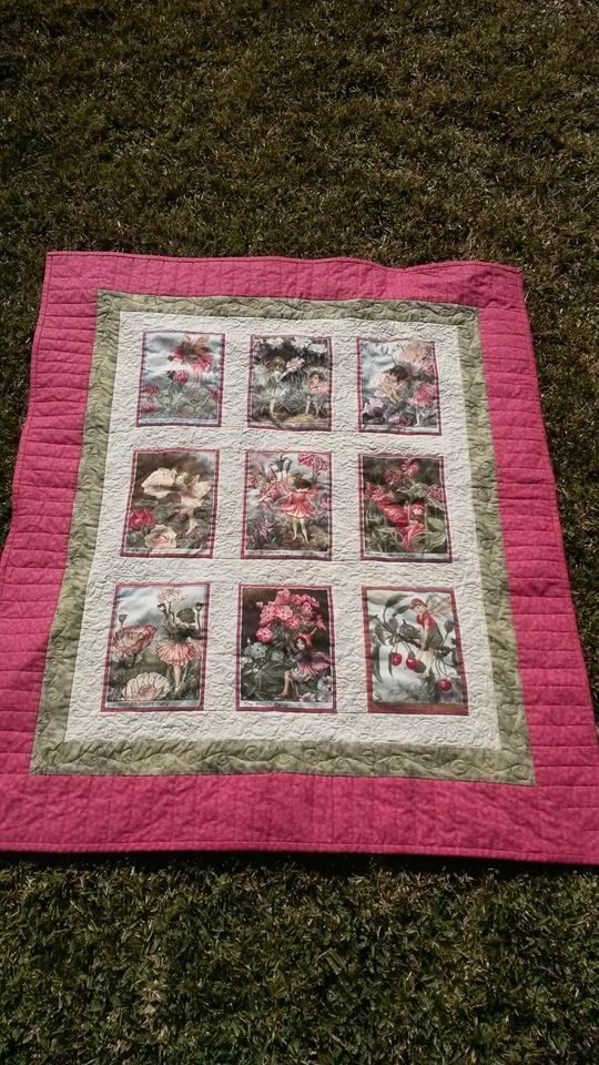 This quilt was made from a panel cut up and pieced. It was made for my daughter's best friend who is expecting her first baby. Very simple but very cute!