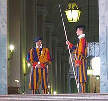"""The tailors of the Swiss Guard uniforms work inside the Pontifical barracks and tailor-make the uniform for each guardsman individually. The uniform weighs 8 pounds, and may be the heaviest uniform in use by any standing army today. The Renaissance style makes them one of the most complicated to construct. A single uniform requires 154 pieces and takes nearly 32 hours and 3 fittings to complete."