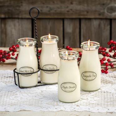 Milk Bottle Candles Will Delight     These charming candles may just remind you the days of the milkman when he delivered fresh milk by the bottle. Their nostalgic glass milk bottles are enough to bring a smile. Just wait until they're lit.     Made of natural soy and beeswax with soothing scents   White wax gives it the look of milk   Paraffin free   Burn time: 50 hours   Each 8 oz, 5-1/2L   USA made      Note:  Metal carrier sold separately.