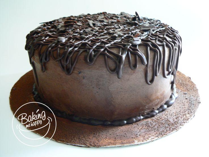 Three layer Dark, moist chocolate cake with chocolate ganache filling and Frosting #DarkChocolateCake #ChocolateGanache #BakingMeHappy