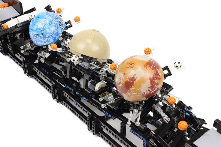 Another fantastic and hypnotic LEGO great ball contraption module by builder Akiyuki, his latest machine is designed to pickup tiny LEGO soccer balls and basketballs and put them into planetary orbits. The planetary hemispheres came from various Star Wars sets.