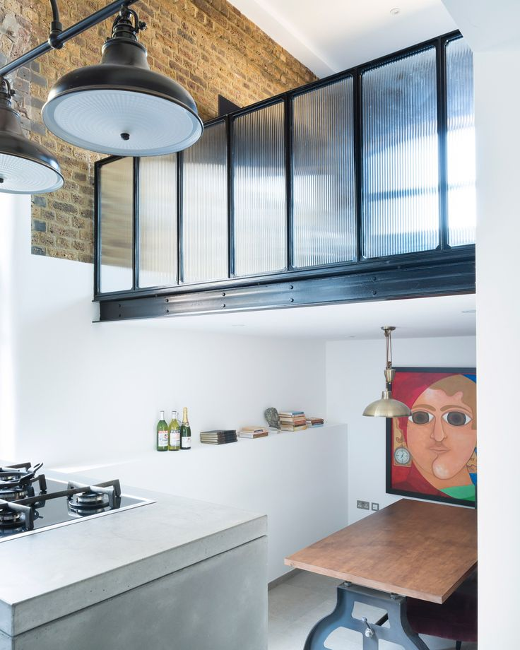London studio Feix & Merlin lowered the floors and raised the ceiling inside this former warehouse to transform it from a cramped apartment into a spacious open-plan residence.