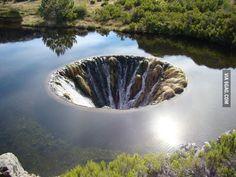 Hole in the dam reservoir of Covão dos Conchos, in the Serra da Estrela.