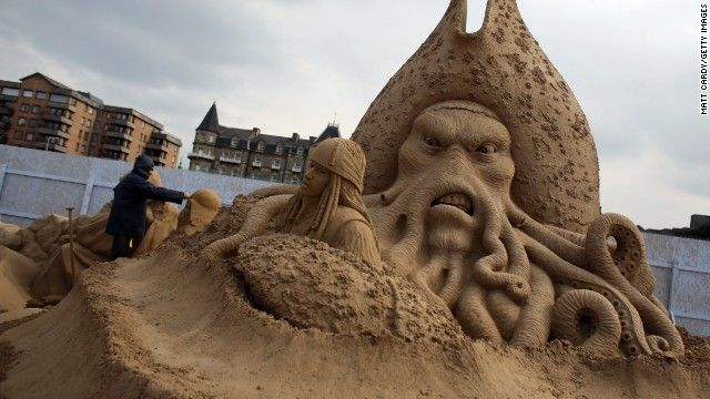 """Where in the world ... ?    (CNN) -- [Updated 4:15 p.m. Monday, April 1] This sand sculpture in Weston-super-Mare, England, portrays Davy Jones and Jack Sparrow, two iconic characters from the """"Pirates of the Caribbean"""" film series.  It is part of the annual Weston Sand Sculpture Festival, which opened Friday and includes work from some of the world's greatest sand sculptors."""