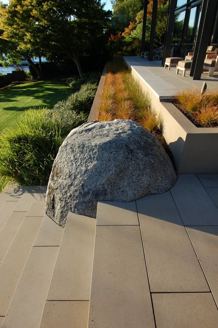 Wow! Love this modern setting and how the boulder meets the cascading steps...