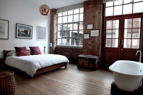 windows, exposed brick, bare plank floors, old double doors, old fashioned tub, just perfect