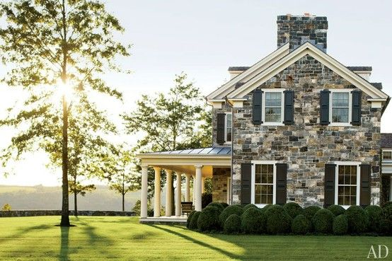 old stone home with white trim and black shutters... LOVE THIS HOUSE