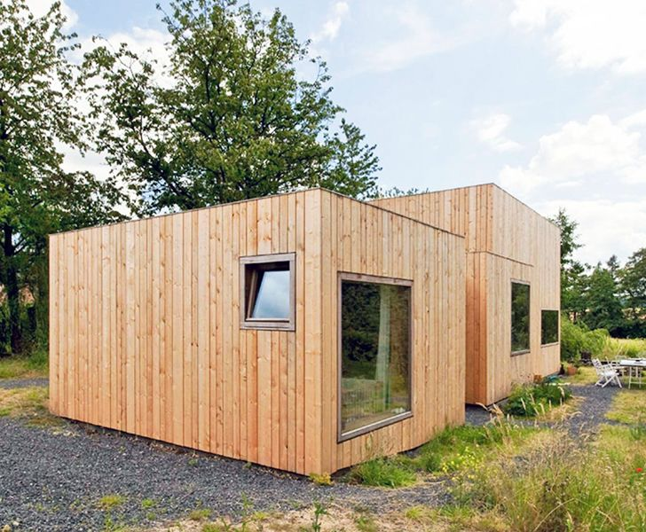 m architecture designed a contemporary cabin-like home in Belgium with 14 different façades.