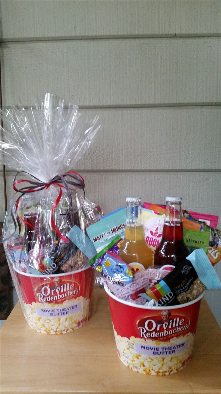 Popcorn tubs filled with gourmet goodies. We can add movie tickets!