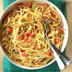 Linguine with Fresh Tomatoes Recipe -This garlic and basil pasta is a perfect way to use up your late-summer tomato harvest. It makes a great light supper when paired with a salad or can be made heartier with some chopped chicken. —Susan Jones, Downers Grove, Illinois
