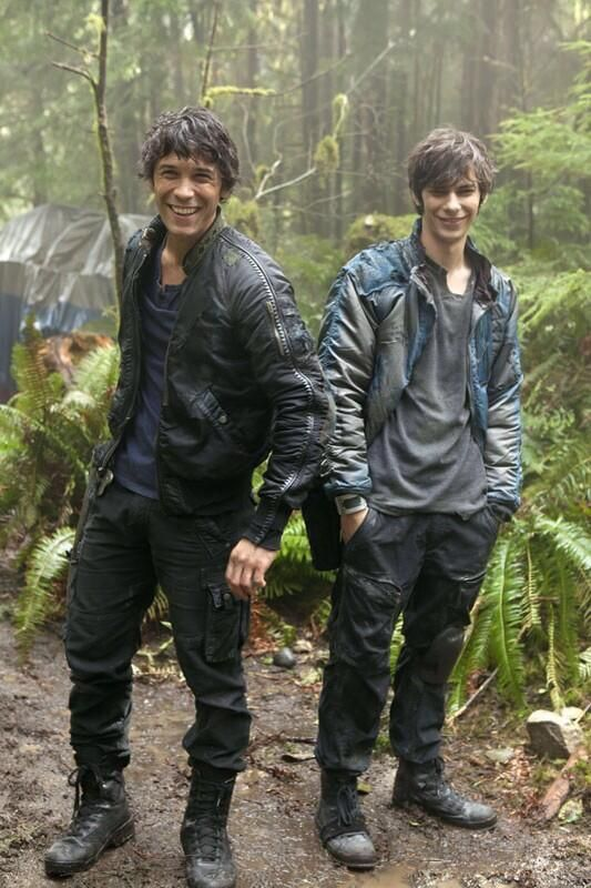 """Msg to """"shitle"""" This is Jasper and Bellamy from The 100...and they'd never do something like this. (Be one of the guys?) I walk through the woods, wearing my usual clothes. Dark wash skinny jeans, hunting boots, a black shirt and a brown hunting jacket. As well as my bow and arrows which were hidden in a tree. I was heading to my spot when I hear a whistle. I look to my right and see two boys grinning at me. """"Hello."""" One of them smirks. I only scoff and continue to walk. Then the other stops…"""