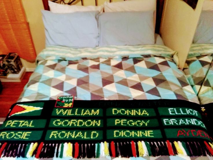 Crochet bed throw with Guyana Flag and Family names. Crochet by me (M).