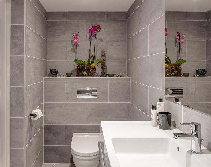 Grey slate tile bathroom.