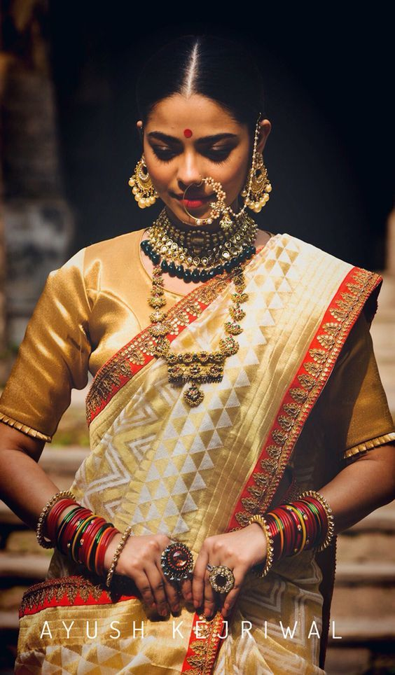 Couturier Ayush Kejriwal aces the south Indian bridal fashion with this white and gold silk saree in aztec print and sari border.