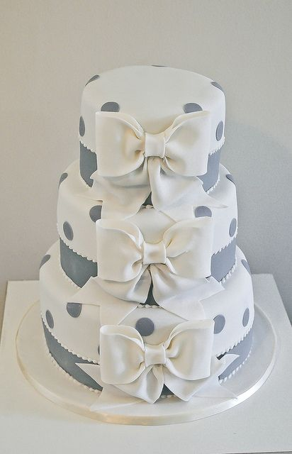 Grey and white polka dotted cake with bows.  Different, and pretty.