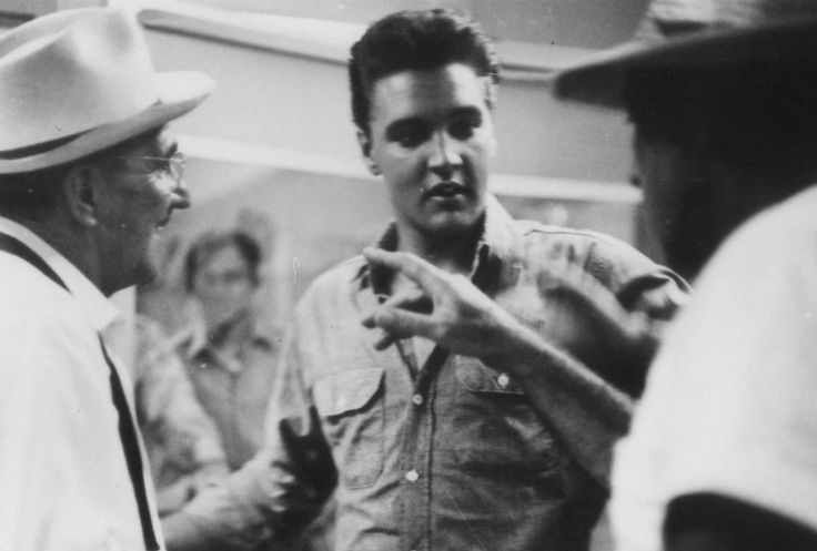 """Elvis rehearsing the bank scene for """"Follow That Dream"""" with Howard McNear"""