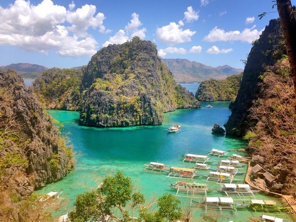 Kayangan Lake, Coron, Philippines — by leealle lee. breathtaking place even amidst chattering tourists... will definitely be back