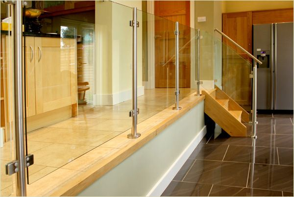 Glass panels replace spindles in this design