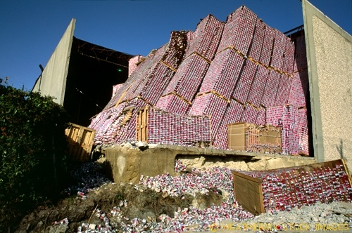 A warehouse damaged by a passing tornado shows it's bounty of stored Pepsi cans in Houston Texas.