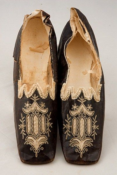 "Lady's Chameleon Shoes, circa 1830-1850. (This style of slipper is called ""Chameleon"" because, like the color-changing lizard, they could be embroidered in any color to match any gown!)"