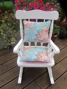 vintage rocking chair with pillows