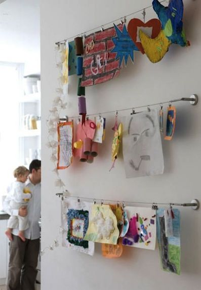 IKEA - how to hang kids' art without putting a million tacks in the wall!