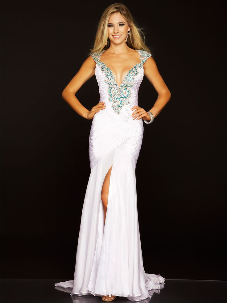Mac Duggal pageant gown 42586P! This white pageant dress features stunning beaded cap sleeves, a down to there V cut neckline that is lined with A.B. and blue colored Swarovski crystals.