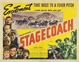 STAGECOACH (1939) - Claire Trevor - John Wayne - Andy Devine - John Carradine - Thomas Mitchell - Louise Platt - George Bancroft - Tim Holt - Based on story by Ernest Haycox - Produced by Walter Wanger - Directed by John Ford - United Artists - Movie Poster.