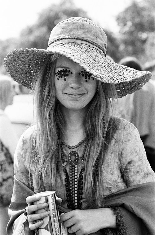 Girl at a Rolling Stones concert in 1969. Long sleeve tunics, vest, boots