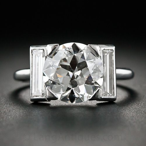 Cartier 3.28 Carat Art Deco Diamond Ring A rare and ravishing beauty. From Cartier-Paris, circa 1930s, a gorgeous, bright-white European-cut diamond, weighing 3.28 carats, sizzles between a pair of long and slender straight baguette diamonds (.50 carats total) set in platinum.