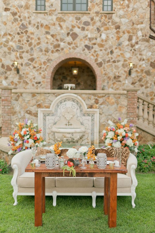 sweetheart couch and table http://www.weddingchicks.com/2013/10/07/travel-themed-wedding-3/