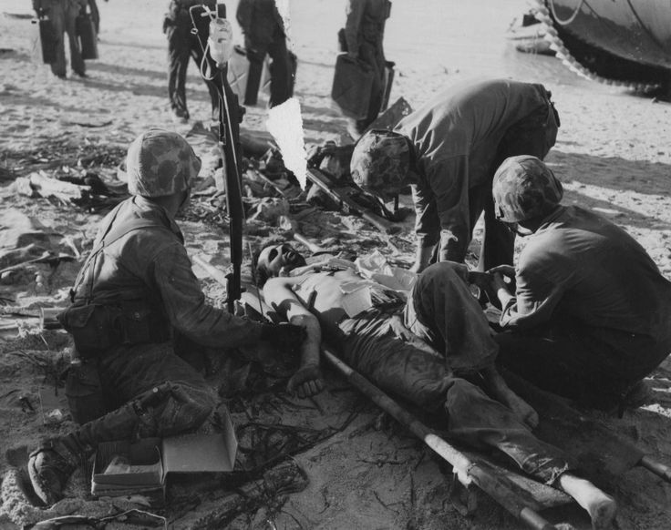 Medics US Marine Corps do transfusion of blood plasma wounded on the beach atoll of Tarawa.