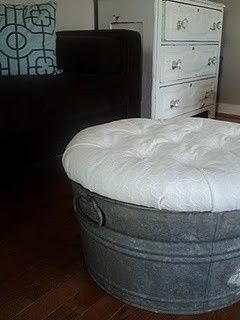 Super easy ottoman made from a galvanized tub, round piece of wood, stuffing, and fabric! Perfect for an outside porch!
