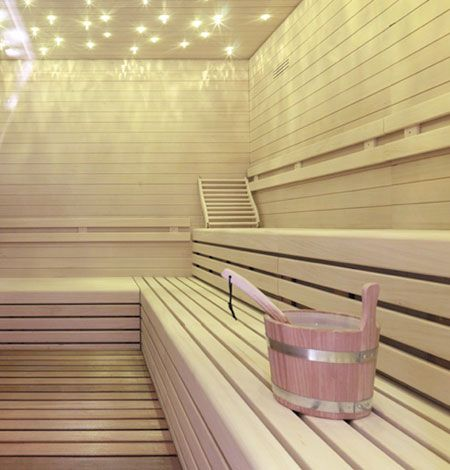 Sauna with small lights in ceiling.