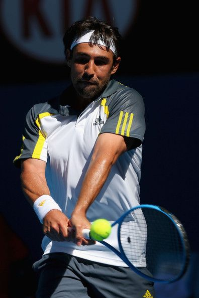 Marcos Baghdatis of Cyprus plays a backhand in his second round match against Tatsuma Ito of Japan during day three of the 2013 Australian Open at Melbourne Park on January 16, 2013 in Melbourne, Australia.