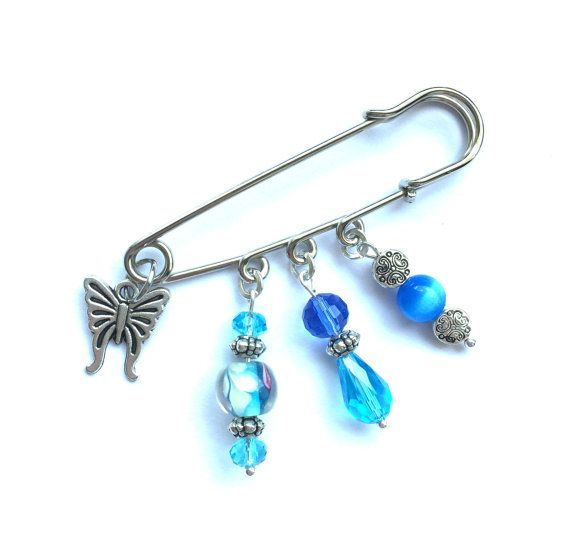Safety pin brooch with butterly charm turquoise and blue