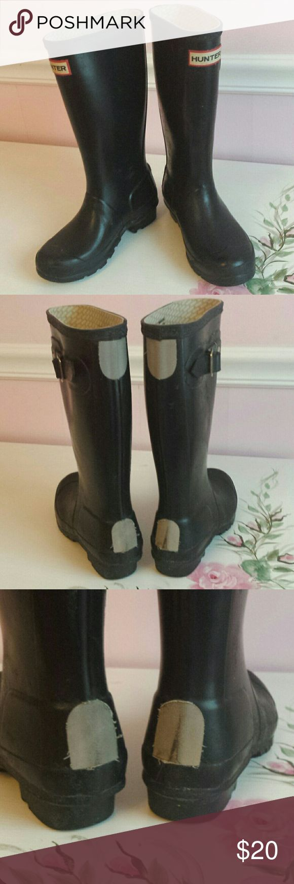 Girls Hunter Boots Black little girls Hunter boots, size 1M. Some fraying around reflective covering on back and one is slighly loose (see pic) Scuffs and some texturing to outer but boots still in good useable condition. Hunter Boots Shoes Boots