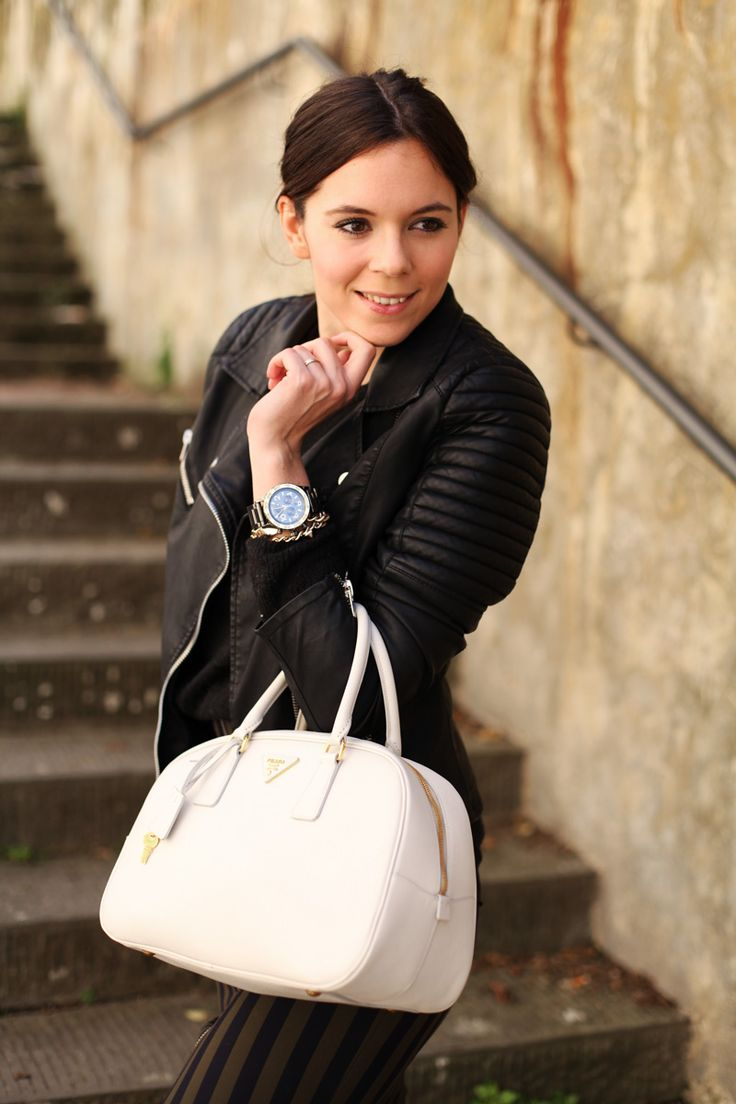 White tote by Prada and leather jacket by Stradivarius