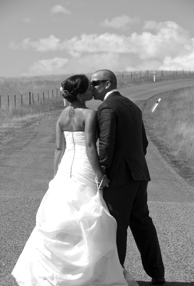 We're now married :-) this couple enjoy a kiss on the road up to Mt John at Lake Tekapo New Zealand