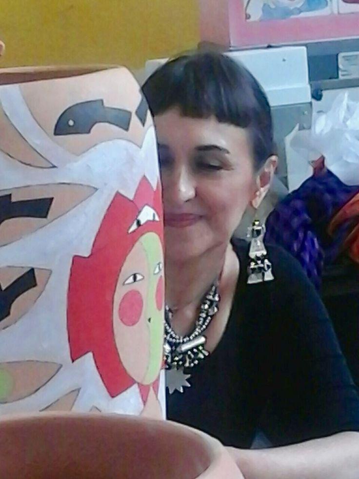 Marianna Bussola painting a vase for Tam Tam Normali Meraviglie la Ceramica