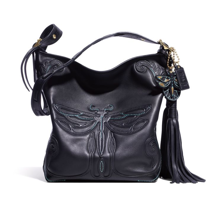 And here's the item I shall always have a broken-heart about, being a student now and not having 798$ to shed on: Anna Sui for Coach Duffle Bag, Dragonfly version. Its beautiful leather, the dragonfly charm and especially, the fantastic tassels make it unforgettable.
